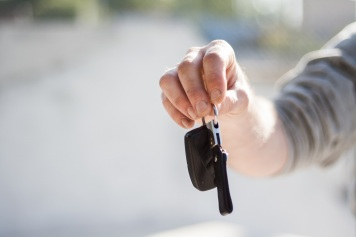 person-handing-over-keys